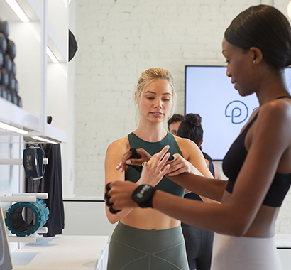 P.volve trainer helps to fit member with proprietary equipment in the lobby